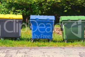 Green, blue and yellow dumpster