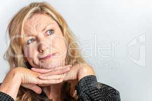 Middle Aged Woman Looking Inquisitive or Questioning