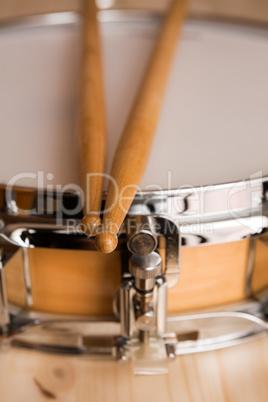 Drum sticks over a snare drum