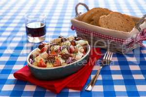 Greek salad with feta cheese olives tomatoes cucumber and onions