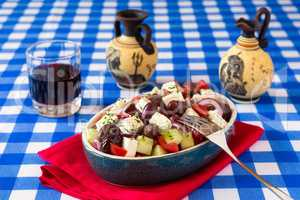 Greek salad with feta cheese tomatoes cucumber olives and onions