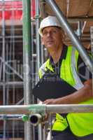 Construction Foreman Builder on Building Site With Clipboard