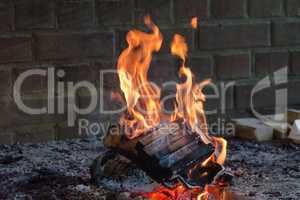 Open fireplace with burning firewood