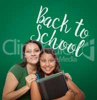 Back To School Written On Chalk Board Behind Proud Hispanic Mom