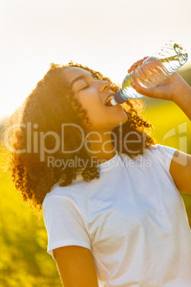 Mixed Race African American Girl Teenager Drinking Water at Suns