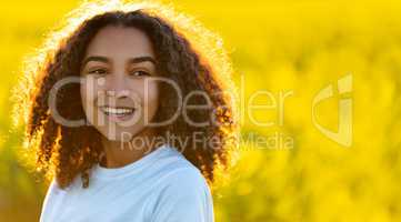 Happy Mixed Race African American Teenager Woman in Yellow Flowe