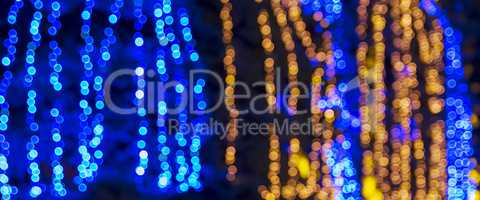 abstract blurred background with round blue and yellow bokeh