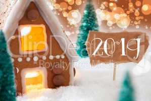 Gingerbread House, Bronze Background, Text 2019, Snowy Bokeh Atmosphere