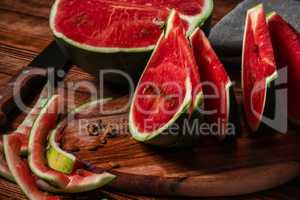 Watermelon slices and peels lying on cutting board