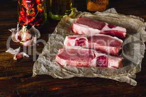 Raw Pork Loin Steaks with Spices.