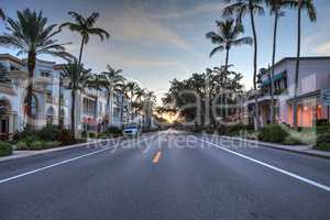 Daybreak over the shops along 5th Street in Old Naples, Florida.