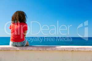 Young Woman Girl Teenager Sitting Wall Looking to Sea