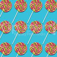Arrangement of lollipop candies on turquoise background