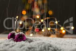 Christmas balls with an electric garland while snowing