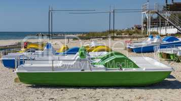 many catamarans on the sandy beach of the sea
