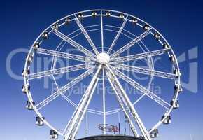 white Ferris wheel with blue background