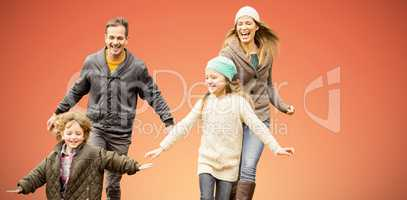 Composite image of cute family is running in a park