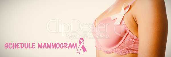 Composite image of schedule mammogram text with breast cancer awareness ribbon