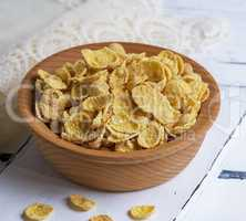 cornflakes in a brown wooden bowl