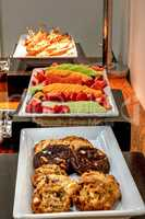 Buffet spread including grilled Reuben sandwiches under a heater