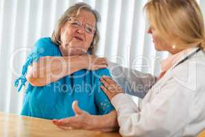Senior Adult Woman Talking with Female Doctor About Sore Shoulder