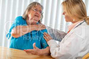 Senior Adult Woman Talking with Female Doctor About Sore Shoulders
