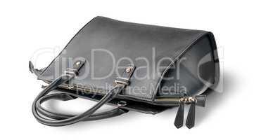 Ladies black leather bag lying