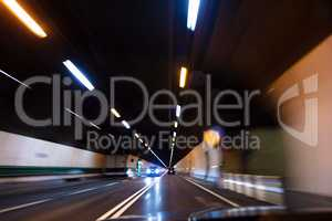 Motion Blur Driving Car at Speed Through a Tunnel at Night