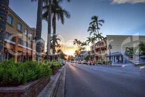 Sunset over the shops along 5th Street in Old Naples, Florida.