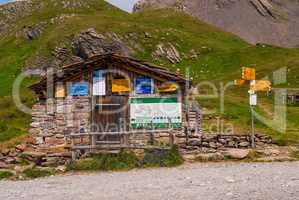 old stone Chalet on the shore of a small lake in the Alpine mountains. Grindelwald Switzerland