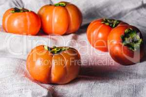 Persimmons on whita textile