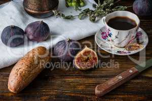 Breakfast with coffee, bread and few figs.