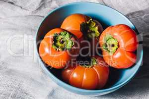 Bowl with Persimmons on White Textile