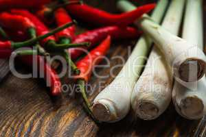 Mexican chili peppers with lemongrass scattered on the wooden table