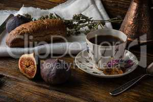 Light breakfast with coffee, bread and few figs.