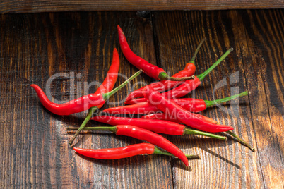 Pile of thai Bird's Eye Chilis on a old wooden table