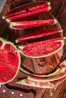 Watermelon slices and peels lying on the board
