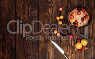 Breakfast table with porridge, fruits and berries