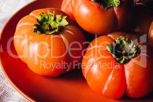 Ripe Persimmons on Plate
