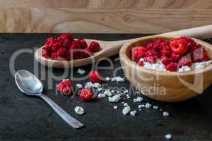 Bowl of cottage cheese with raspberries for breakfast