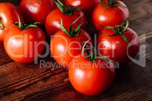 Some Red Tomatoes on Wooden Table