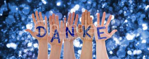 Hands Building Danke Means Thank You, Glittering Bokeh Background