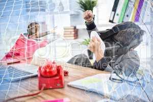 Composite image of boy imitating businessman using virtual reality headset
