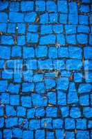 blue painted cobblestones, parking for handicapped