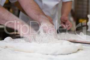 Kneader preparing focaccia romana