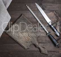 knife sharpener, knife and old empty wooden cutting board