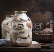 salted pieces of lard with meat are closed in glass jars