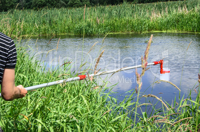 Take samples of water for laboratory testing. The concept - analysis of water purity, environment, ecology.