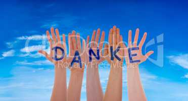 Many Hands Building Danke Means Thank You, Blue Cloudy Sky