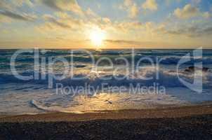 Sunset on a windy Ionian beach